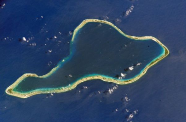 Top: Moruroa Atoll. Bottom: Fangataufa Atoll, French Polynesia, sites of French nuclear tests. The dark blue waters in the upper lagoon of Fangataufa mark the deep crater created by bomb explosions. Credit: NASA, via Wikimedia Commons.