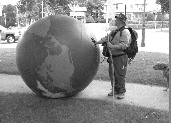 World on a String: Erik Bendl, 48, of Louisive, KY, is pushing this to-scale (maybe) model of the Earth from Washington, DC to Maine to raise awareness of Diabetes (Photo: Alex Gontar).