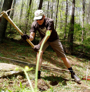 Actionshot--The author helps build a fence for the chicken yard, spring 2011.