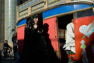 A woman walks in front of the Great Mosque in central Herat.