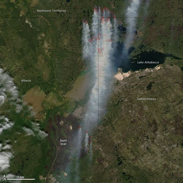 Thick smoke from drought- and heat-ravaged Canada streams south towards US. Wildfires outlined in red. Credit: Jeff Schmaltz, MODIS Rapid Response Team at NASA GSFC.