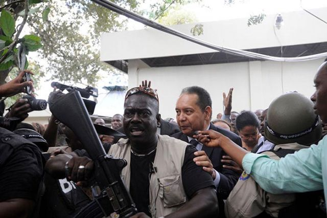 Baby Doc being led into the courthouse in Port Au Prince.