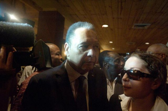 Duvalier and his companion, Veronique Roy, at the Karibe Hotel.