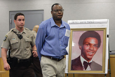 Jerry Johnson at Tim Cole's exoneration hearing in 2009.: Harry Cabluck/AP Photo