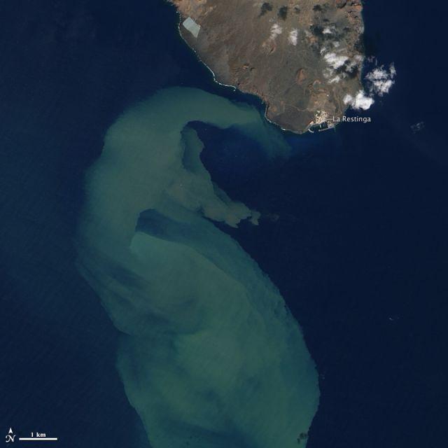 El Hierro and of El Hierro and plume of volcanic material, 2 Nov 2011.: Credit: NASA image by Jesse Allen and Robert Simmon, using ALI data from the EO-1 Team.