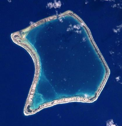 Top: Moruroa Atoll. Bottom: Fangataufa Atoll, French Polynesia, sites of French nuclear tests. The dark blue waters in the upper lagoon of Fangataufa mark the deep crater created by bomb explosions. Credit for both: NASA, via Wikimedia Commons.