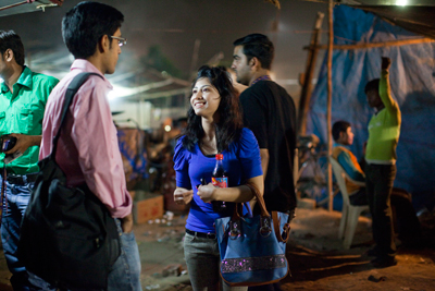 Monica Joshi, 22, kills some time before her graveyard shift at a Gurgaon call center.