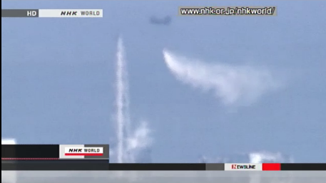 A helicpoter dropping water on the Fukushima Daiichi nuclear plant