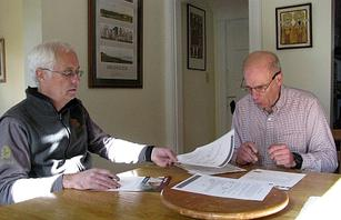 Kitchen-table economics: Paul (left) talks energy savings with Langdon.