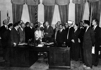 President Dwight D. Eisenhower in the Oval Office with a group of Muslim delegates, 1953. Said Ramadan is second from the right.