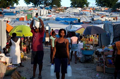 The main market in one of the 1,300 tent cities that pock Port-au-Prince, makeshift encampments home to 1.2 million people and terrorized by gangs of rapists.