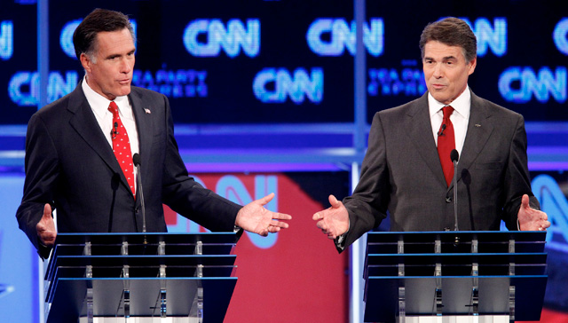 Mitt Romney and Rick Perry at the CNN/Tea Party Express on September 12, 2011.: Edmund D. Fountain/St. Petersburg Times/Zuma