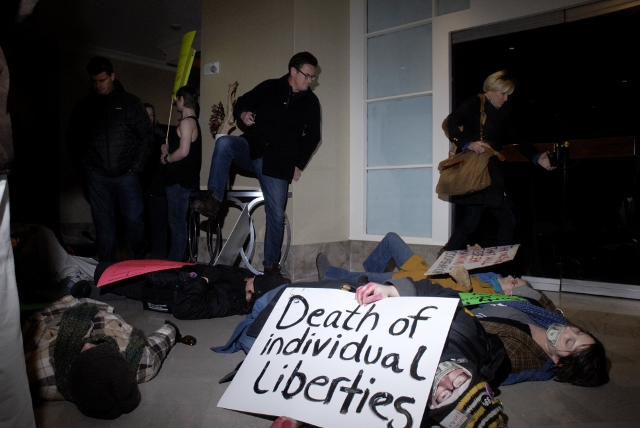 Joe Scarborough, host of MSNBC's Morning Joes, steps over Occupy protesters staging a die-in at a Des Moines hotel.: Joe Scott