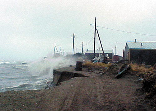 Shishmaref village, Alaska, inhabited for 400 years, battered by storm waves.: Credit: NOAA.