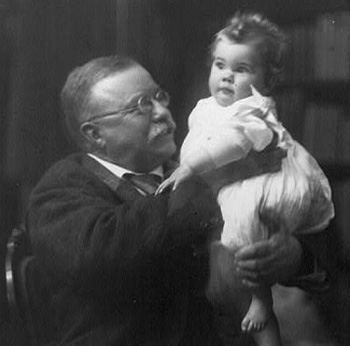 Speak softly and don't kiss babies: Teddy Roosevelt with his granddaughter.: Library of Congress
