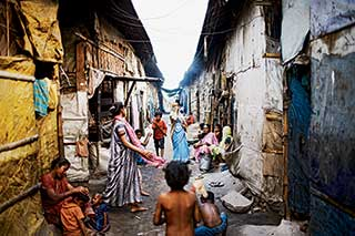 Konica Modol lives in Topsia, a Kolkata slum of shanties and godowns (warehouses). Days after these pictures were taken , fire consumed the slum, leaving 1200 homeless.