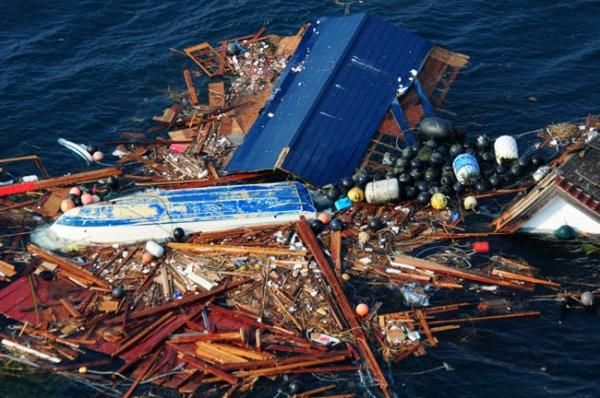 Tsunami debris afloat in the Pacific after the 11 Mar 2011 earthquake and tsunami off Japan.: Credit: US Navy/ Specialist 3rd Class Alexander Tidd.