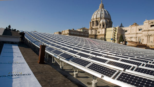 St. Peter's Basilica is seen in the background of a solar panel set up on the roof of the Paul VI Hall at the Vatican. Photo: Evandro Inetti/Zumapress.com
