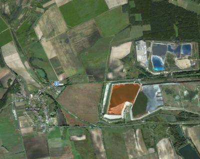 The bauxite residue holding pond, near Kolontar, Hungary, burst on Oct. 4, 2010, leading to human casualties and intense environmental damage. Image courtesy Google Earth