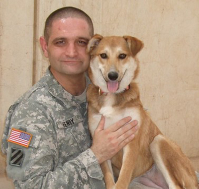 Reunited: With the help of Operation Baghdad Pups, Staff Sgt. Luke Henry, a mental-health specialist, was able to bring home his adopted Iraqi dog, Band-Aid. / Courtesy of Operation Baghdad Pups