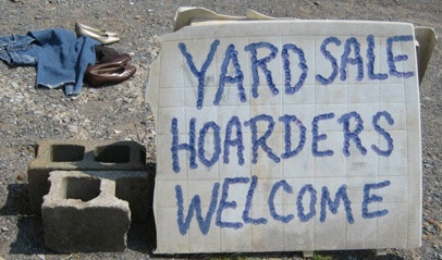 """Truth in Advertising: Shenandoah, Virginia—""""I was just watchin' that movie the other day. You know, that movie, Hoarders,"""" says this sign's owner. """"I turned to my wife and said, 'honey, we're hoarders!'"""" (Photo: Tim Murphy)."""