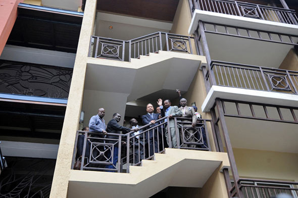 Duvalier waves from the balcony of his hotel before being taken into custody.