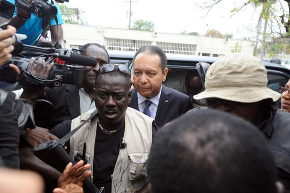 "Jean-Claude ""Baby Doc"" Duvalier being lead into the Port-au-Prince courthouse. Photo by Mark Murrmann"