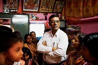 Chairman Chandra Shekhar Ghosh took the hard lessons of his own upbringing to develop a program that serves 2 million women.