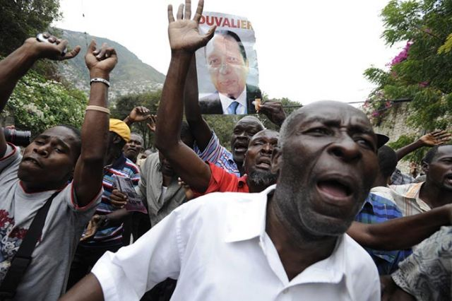 Duvalier supporters gather near the Karibe Hotel.