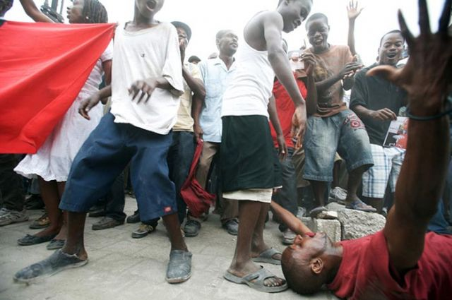 Duvalier supporters dance in front of the courthouse.