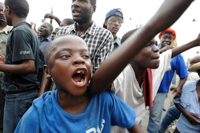 Young Duvalier supporters.