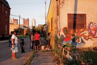 In The Bottoms, just west of downtown Columbus, neighbors paint a mural.