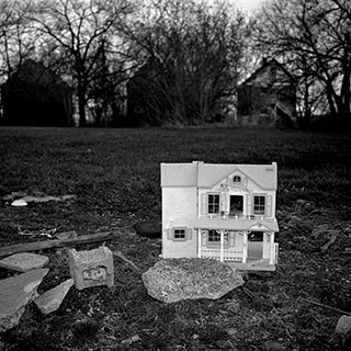 A dollhouse sits in an empty lot not far from where Aiyana was shot by the police officers storming her home.