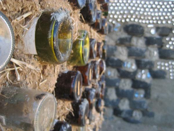 Wine Cellar: Michael Reynolds' Earthships turn junk into building materials (Photo: Tim Murphy).