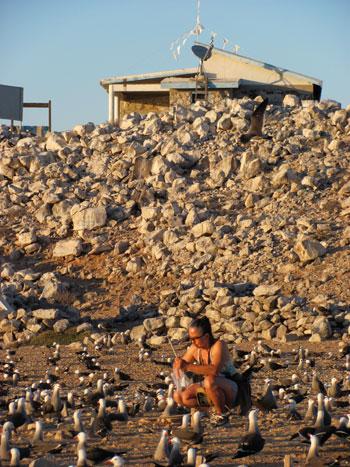 Velarde weighs gulls' eggs on the beach near her hut. : Julia Whitty