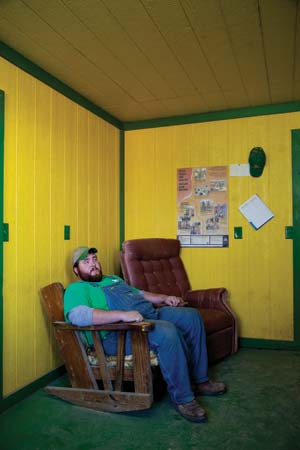 Casey Smith in the John Deere-themed office on his dad's farm