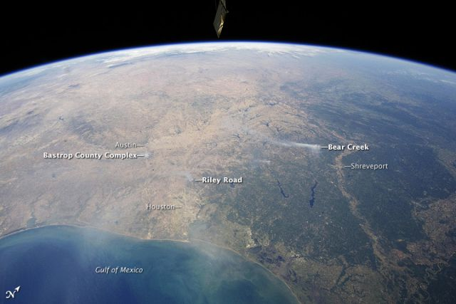 Panoramic view from the International Space Station of east-central Texas on 6 September 2011, with numerous wildfire smoke plumes. Credit: NASA Earth Observatory.