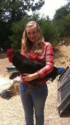 Kendall Post, 14, holds one of her roosters.