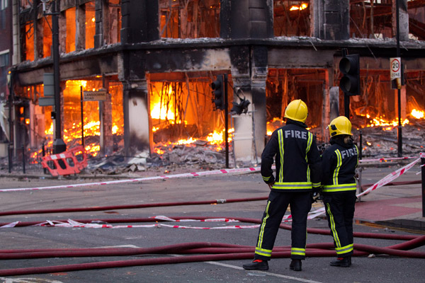 A building burns on Tottenham High Street.: Joel Goodman/ZUMA