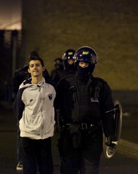 Police arrest a young looter in Bixton, London.: Matt Cetti-Roberts/ZUMA