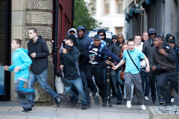 Young rioters run through the streets of Manchester.: Joel Goodman/ZUMA