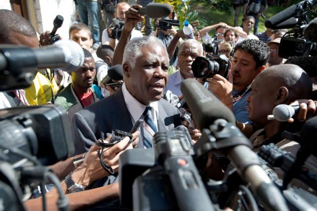 Former Haitian ambassador to France, Henry Robert Sterling, talks to the media outside the hotel Jean-Claude Duvalier is staying in Port-Au-Prince. Duvalier's expected press conference has been post-poned.