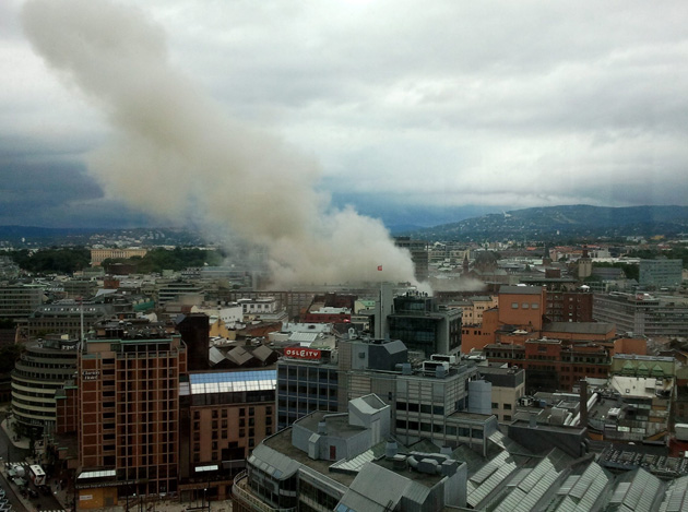 OSLO, NORWAY - Smoke billows from central Oslo Friday after two explosions blasted buildings including the prime minister's office.: Scanpix/Zuma