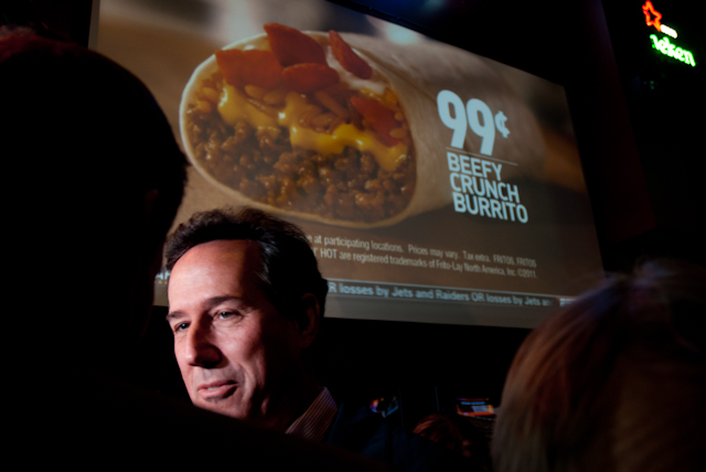 """Get out of the way, there's a game on!"" irritated Iowa State football fans yelled as Santorum, swarmed by the media, blocked their views.: Joe Scott"