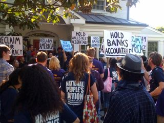 Protesters crowd in front of JPMorgan Chase lobbyist Peter Scher's house in Chevy Chase, Md. Photo by Andy Kroll.