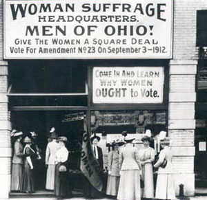 Florence E. Allen, the first female to serve on a State Supreme Court, holds a sign in front of the Woman's suffrage headquarters in Ohio, 1912.