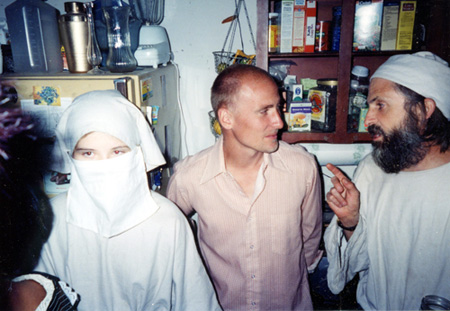ELIZABETH SMART (14) wearing a veil to conceal her identity at a party in Salt Lake City with her captor, Brian David Mitchell (right): Anne Elizabeth Maurer/Zumapress.com
