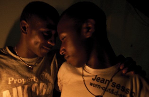 A couple at a gay bar in Kampala that recently opened.: Photographs by Bryan Anselm
