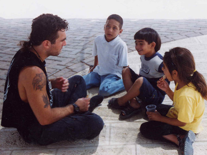 Vittorio Arrigoni talks with Gazan children in this undated photo.: Courtesy Vittorio Arrigoni